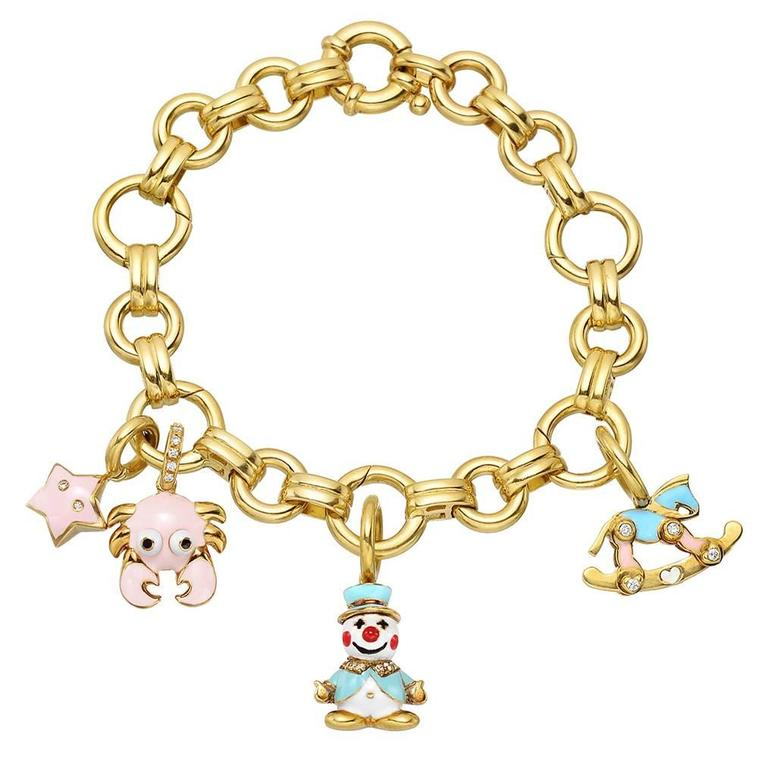 aaron basha gold link bracelet with four charms at 1stdibs