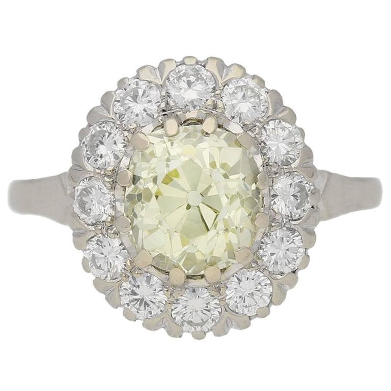 Fancy light yellow diamond cluster ring, circa 1950.