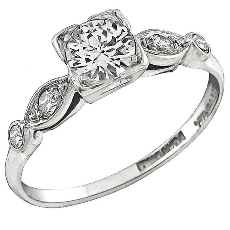 Charming Round Cut Diamond Platinum Engagement Ring