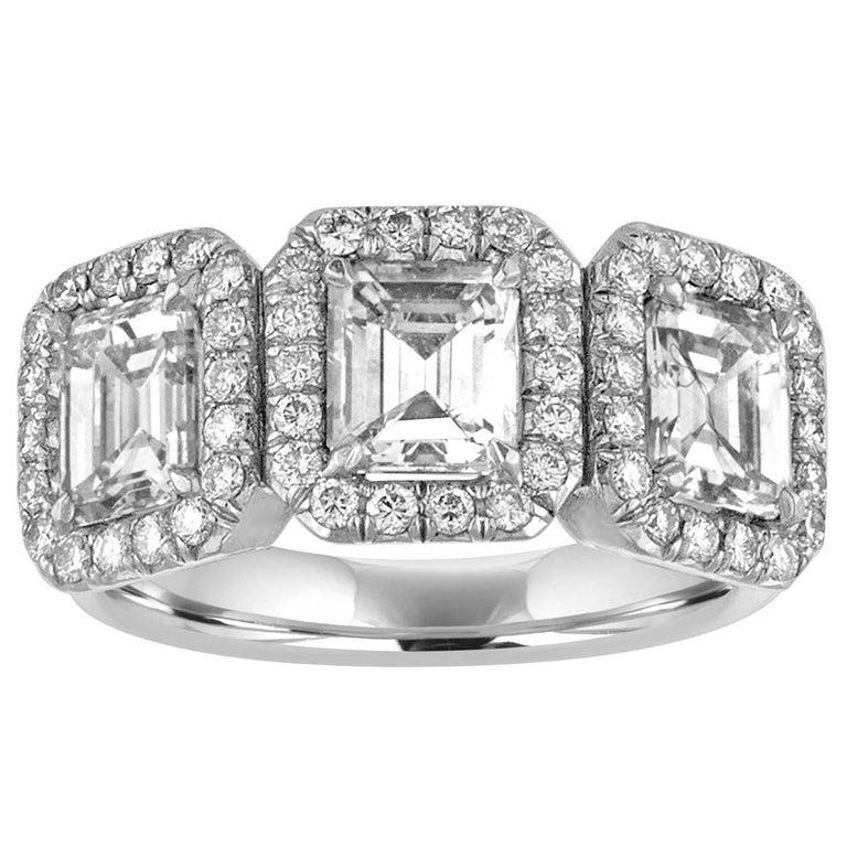 2.80 Carats Diamond Three Stone Emerald Cut Gold Ring For Sale