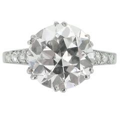 Edwardian solitaire diamond ring with diamond set shoulders, circa 1905.