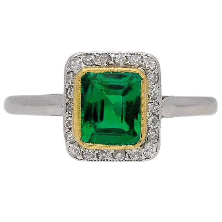 Emerald and diamond cluster ring, circa 1915.