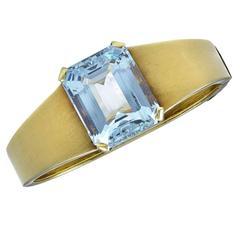 An Aquamarine and Gold Bangle of beautiful simplicity