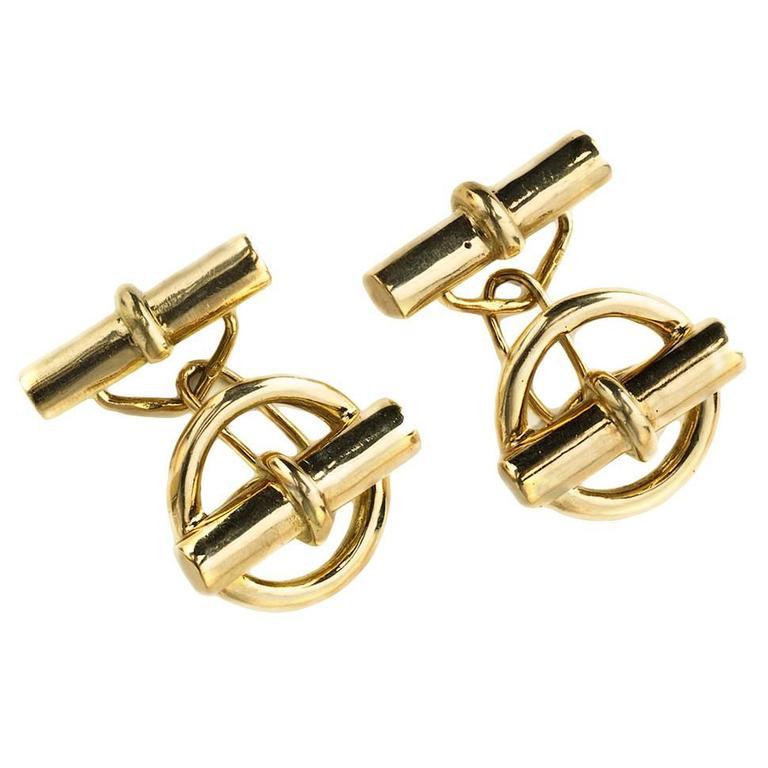 Hermès gold cufflinks