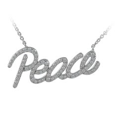 Tiffany & Co. Paloma Picasso Diamond Gold Peace Necklace
