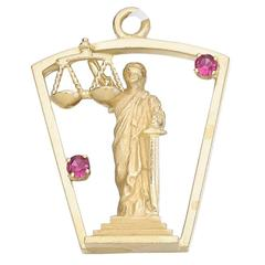 """Ruby and Gold """"Lady Justice"""" Charm"""