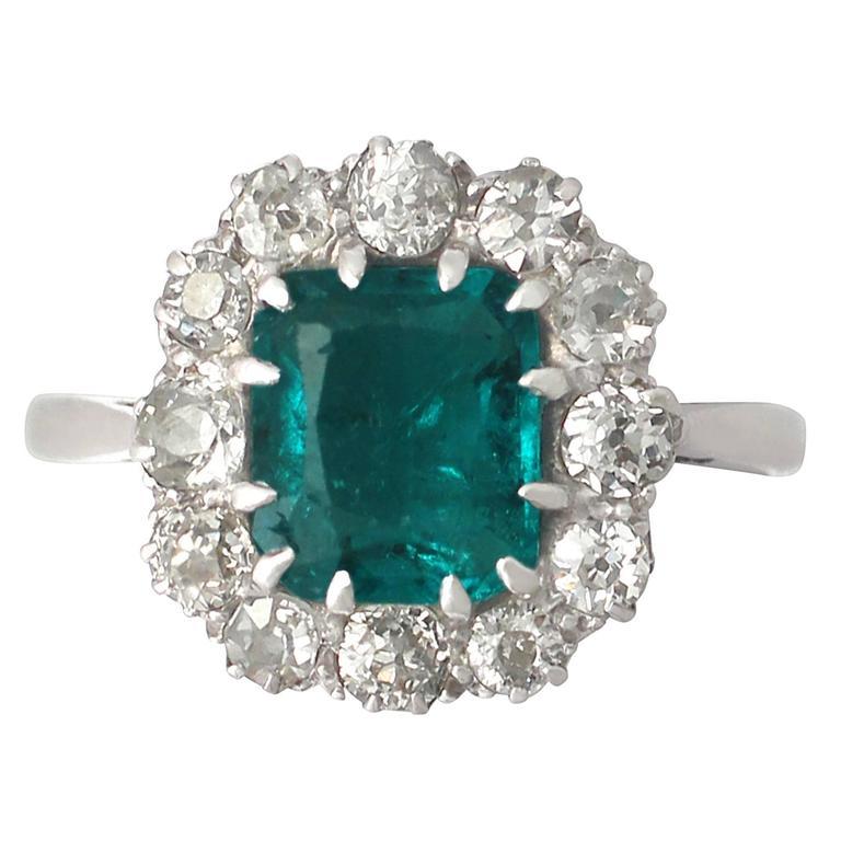 1910s Antique 1.62 Carat Emerald & Diamond Platinum Cluster Ring 1