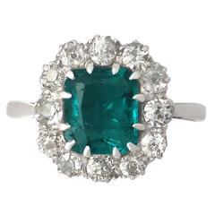 1910s Antique 1.62 Carat Emerald and Diamond Platinum Cluster Ring