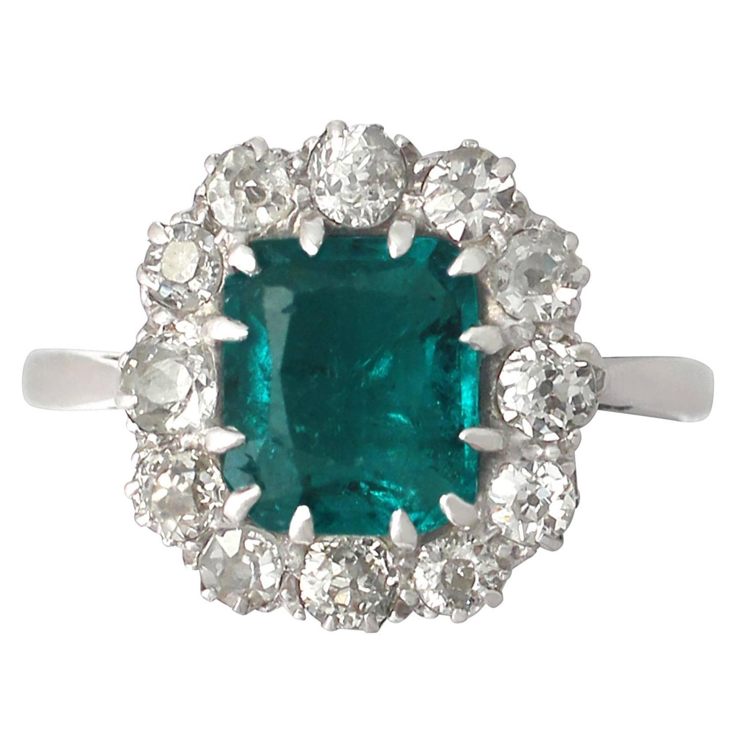 1 62ct emerald and 0 72ct platinum cluster ring