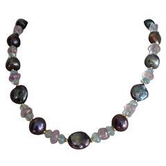 Black pearl ,aquamarine,amethist and gold necklace