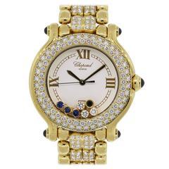 Chopard Lady's Yellow Gold Diamond Sapphire Happy Sport Quartz Wristwatch