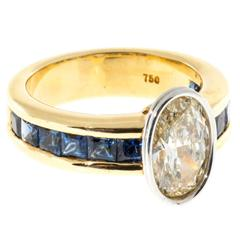 Channel Set Sapphire Oval Diamond Gold Platinum Ring