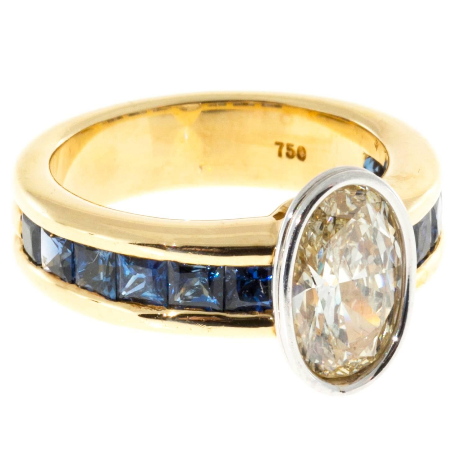 channel set sapphire oval gold platinum ring at