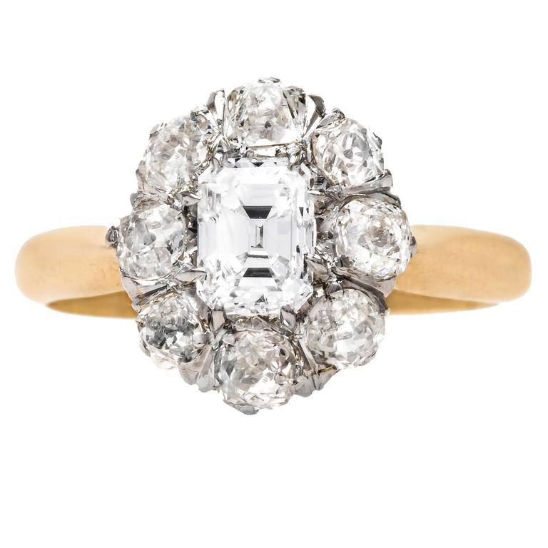 unique cluster engagement ring with emerald cut