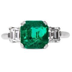 Bold Modern Era Emerald Ring with Square Step Cut Diamonds