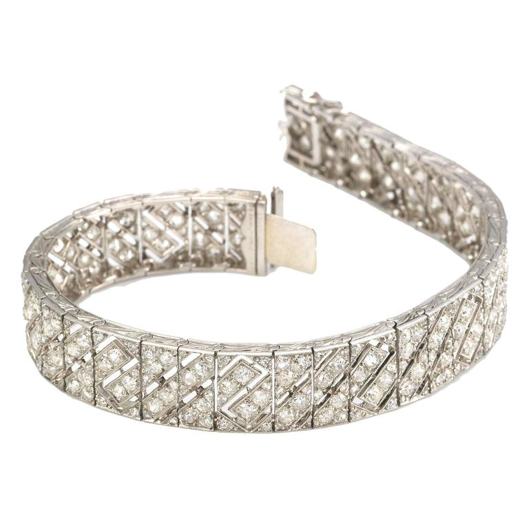 composed band openwork european old diamond pin the of wide bracelet art three deco an flexible