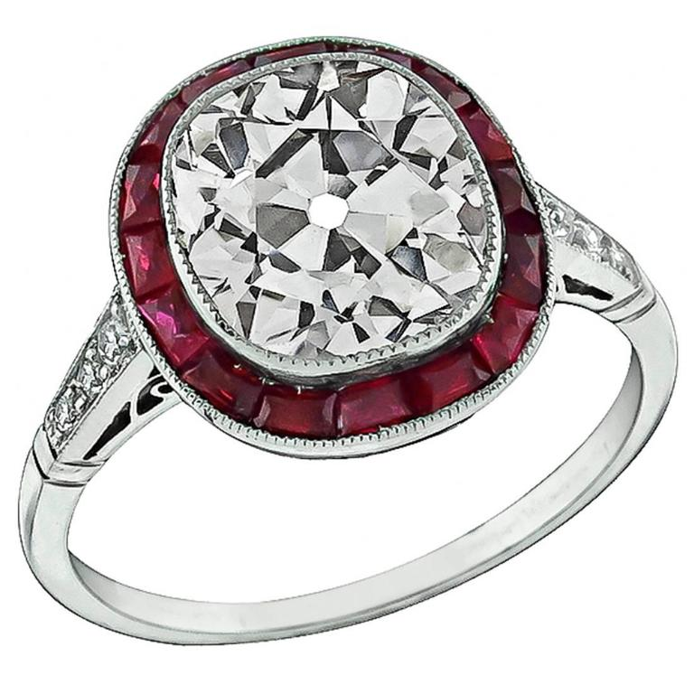 Remarkable 3.56 Carat Old Mine Brilliant Cut Diamond Ruby Platinum Halo Ring For Sale