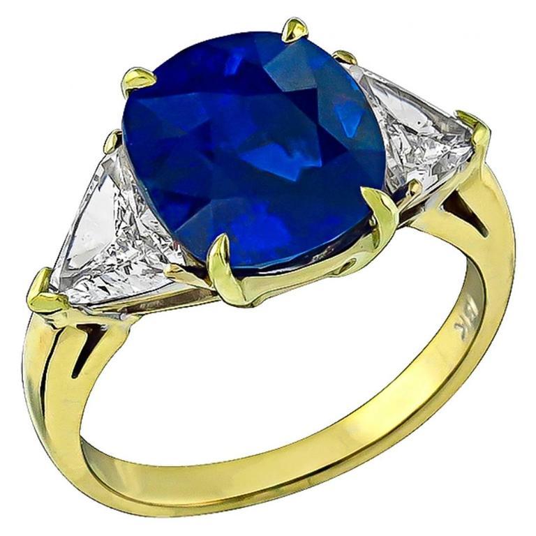 Stunning 5.28 Carat Cushion Cut Sapphire Diamond Gold Engagement Ring For Sale