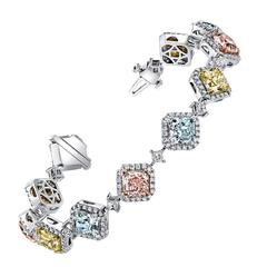 Natural Fancy Colored Pink Blue and Canary Yellow Diamond Platinum Bracelet