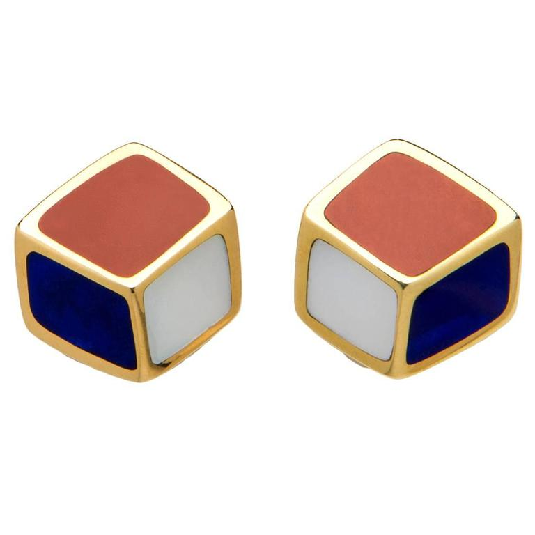 Lapis, Carnelian and Mother of Pearl are a striking combination in this simple geometric design created by Tiffany & Co.  7/8's of an inch in size