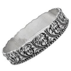 Past Era Tiffany & Co. Late Victorian Silver Cherub Bangle Bracelet