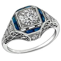 Enticing 0.70 Carat Diamond Sapphire Platinum Engagement Ring