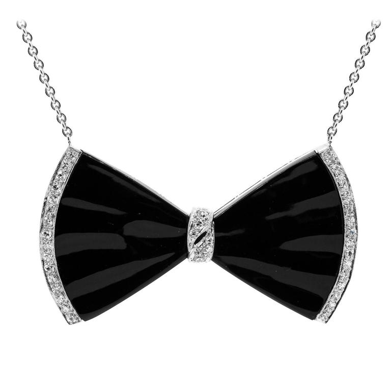 1930s Onyx Diamond Platinum Bow Pendant For Sale