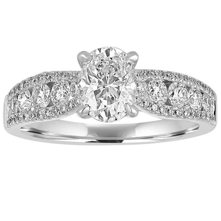 GIA Certified 1.03 Carat D VS2 Oval Diamond Gold Ring