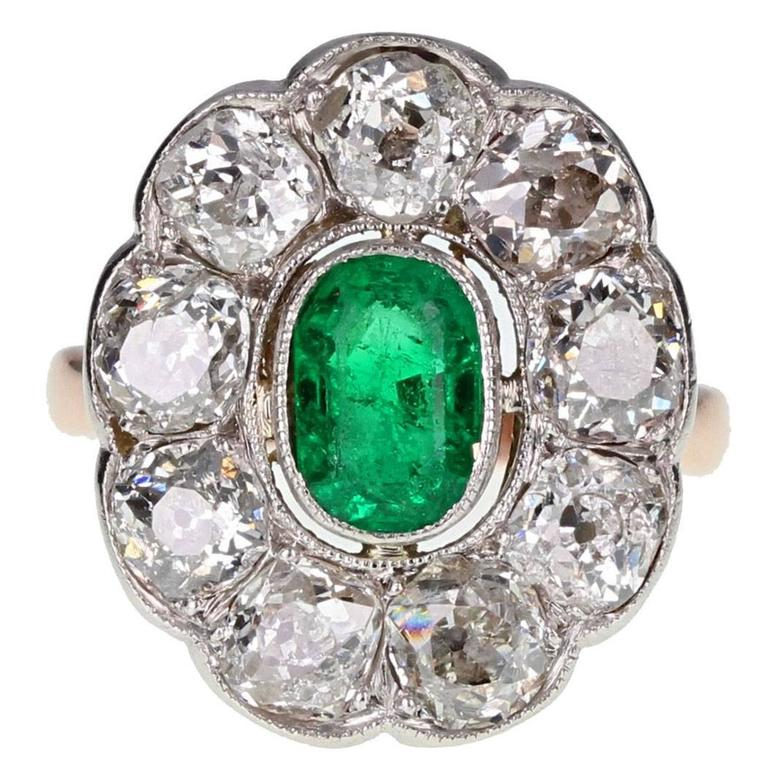 Antique Oval Emerald and Diamond Cluster Ring in Gold