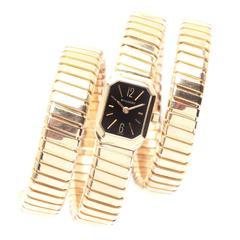 Bulgari Lady's Yellow Gold Black Dial Tubogas Bracelet Wristwatch