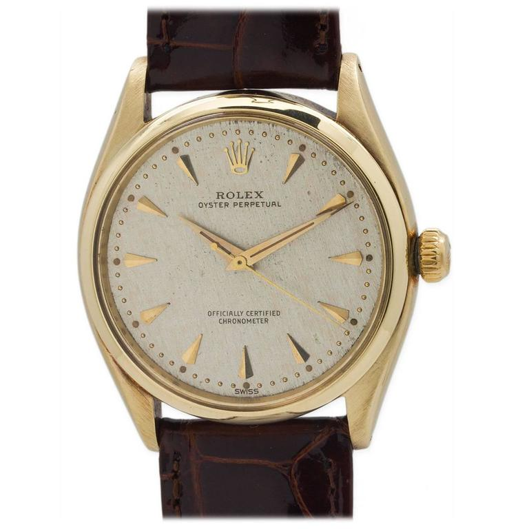 Rolex Yellow Gold Oyster Perpetual Wristwatch Ref 6564 circa 1960 For Sale