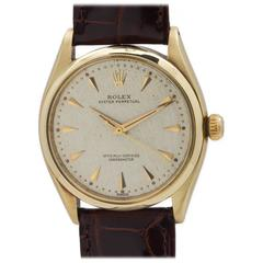 Rolex Yellow Gold Oyster Perpetual Wristwatch Ref 6564 circa 1960