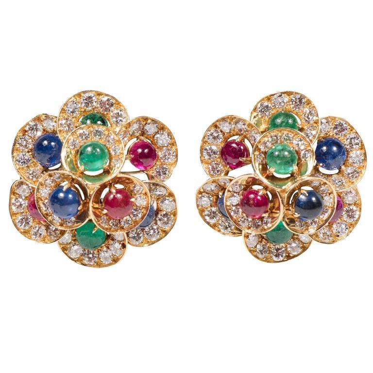 exquisite bulgari diamond emerald sapphire and ruby gold ear