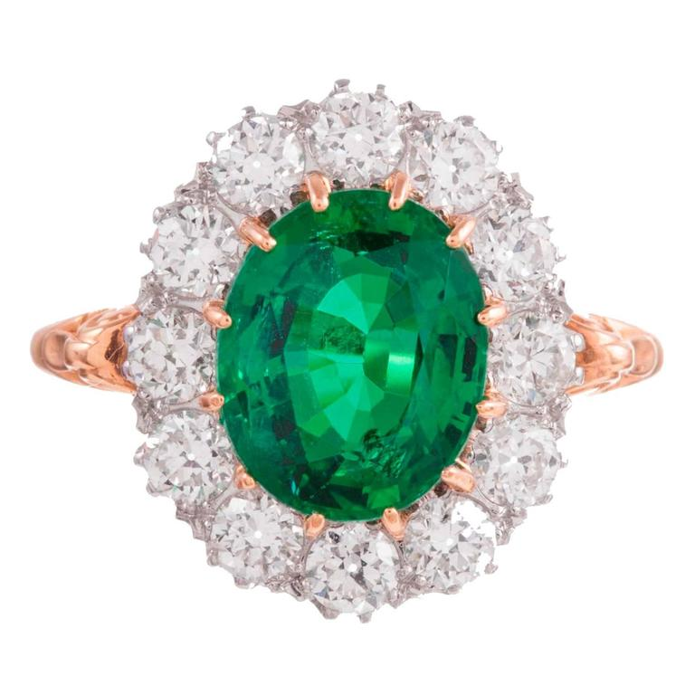 2.73 Carat Emerald Diamond Gold Cluster Ring For Sale