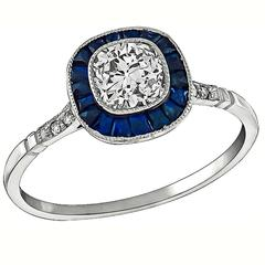 Charming 0.65 Carat Sapphire Diamond Platinum Engagement Ring