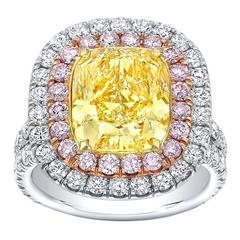 Tamir GIA Certified 4.55 Carat Fancy Light Yellow Diamond Two Color Gold Ring