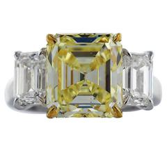 5.28 Carat Emerald Cut Canary Diamond Gold Platinum Ring