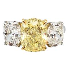 Oscar Heyman 4.28 Carat Fancy Yellow Cushion Cut Three-Stone Diamond Ring