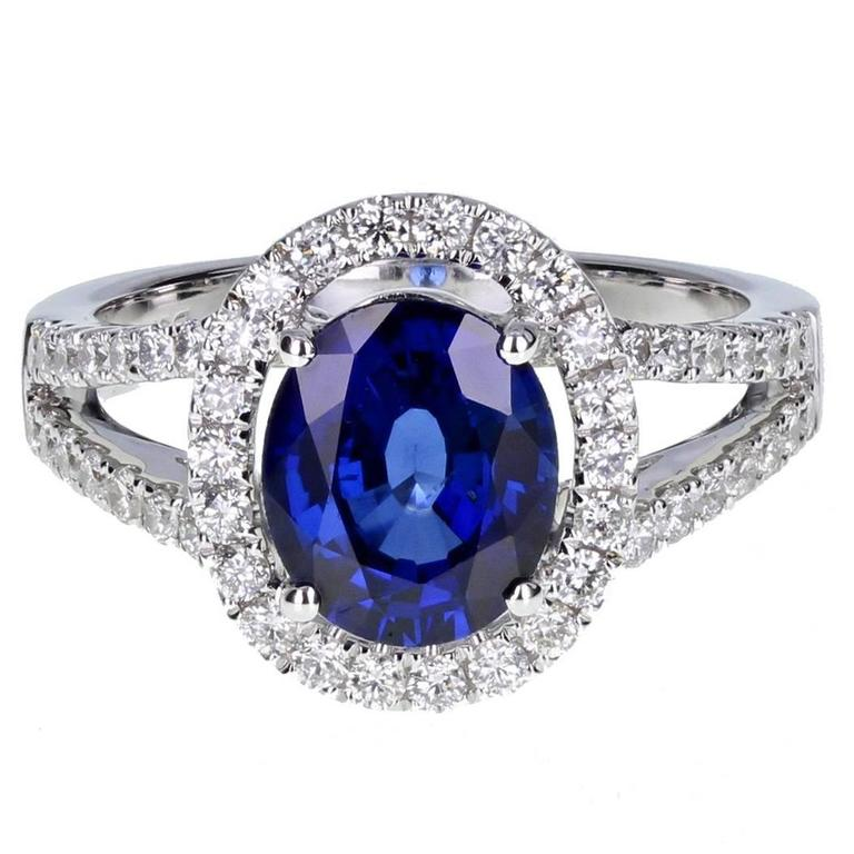 Oval Blue Sapphire Diamond Gold Halo Set Ring at 1stdibs