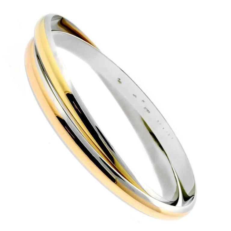 Cartier Interlocking Stainless Steel Gold Bangle Bracelet For Sale
