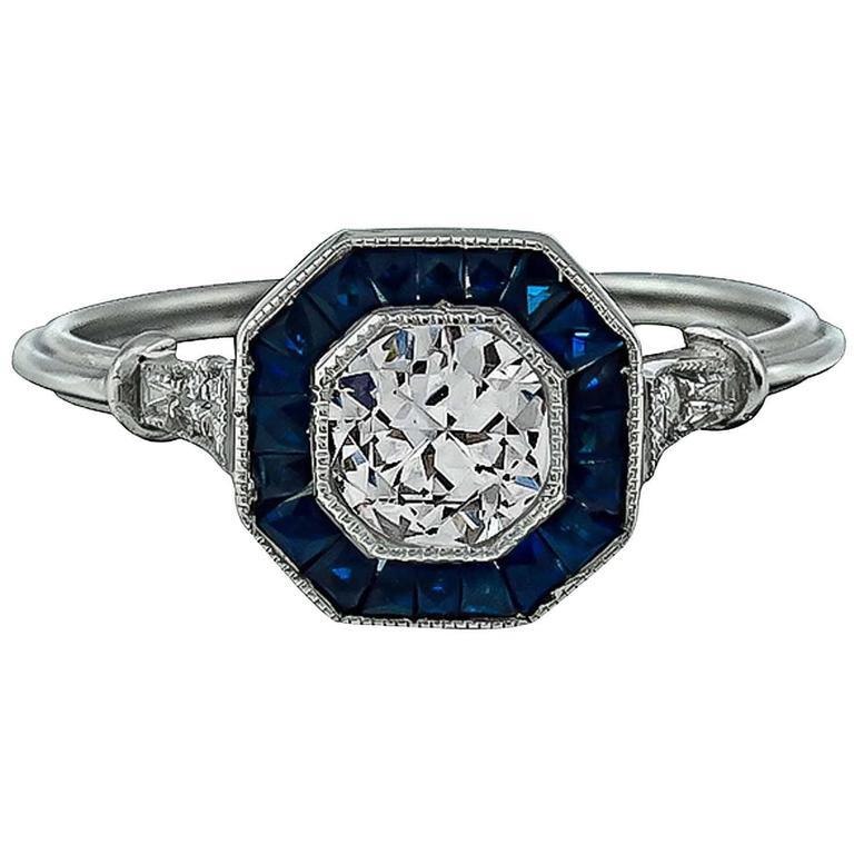 Charming Sapphire Diamond Platinum Engagement Ring