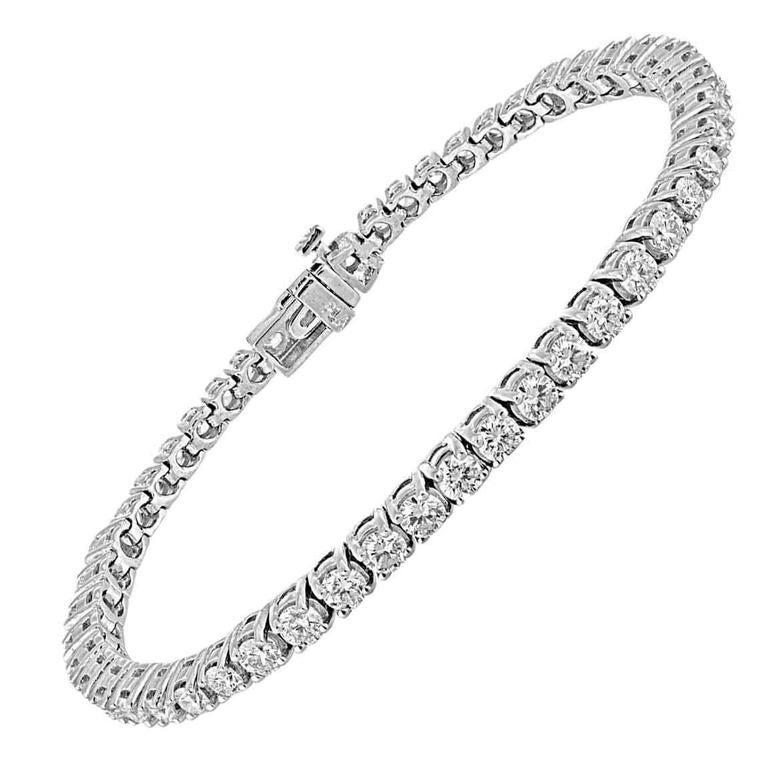 5.22 Carat Diamonds Gold Tennis Bracelet For Sale