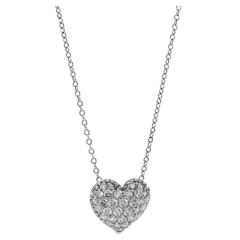 Cartier diamond cross platinum pendant necklace at 1stdibs cartier diamond heart platinum necklace aloadofball Images
