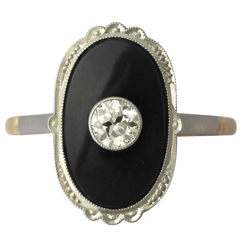 1910s Onyx and Diamond Yellow Gold Cocktail Ring