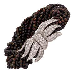 1960s Multi Strand Black Peacock Pearl Diamond Platinum Clasp Bracelet