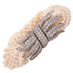 Multi Strand Pearl Diamond Platinum Ribbon Bow Clasp Bracelet