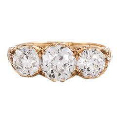 Victorian English Three Stone Diamond Gold Carved Ring