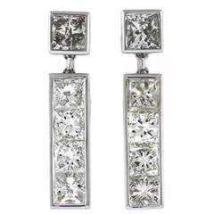 4.25 Carats Channel Set Princess Cut Diamonds Gold Earrings