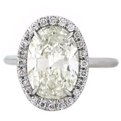 Beautiful 4.01 Carat GIA Oval Diamond Gold Classic Halo Ring