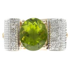Oval Peridot Diamond Swirl Gold Ring